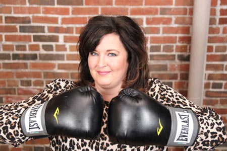Kelle Walters with boxing gloves