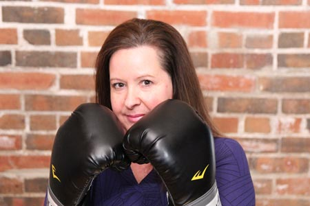 Ronda Benton with boxing gloves
